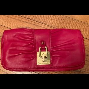 Michael Kors Red leather clutch. Never Used